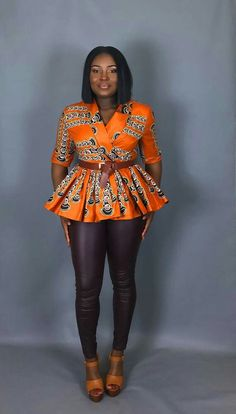 In a gorgeous brightly coloured Java print, the Ampomah Top has a fitted bodice and fashioned with a gathered peplum hem. The perfect lightweight layer. Perfect addition to your fall/winter wardrobe. Short African Dresses, African Blouses, Latest African Fashion Dresses, African Tops, African American Fashion, African Print Fashion, Africa Fashion, African Print Pants, African Attire