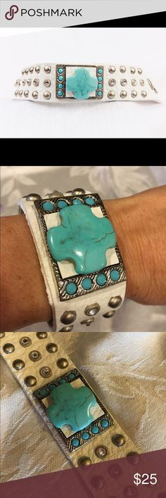 Leatherock bracelet New, never used. There are two available. Beautiful hand tooled white leather with turquoise cross stone, accented with Swarovski crystals and silver studs. Bracelet is adjustable via two snap closures. Price is for one bracelet. leatherock Jewelry Bracelets