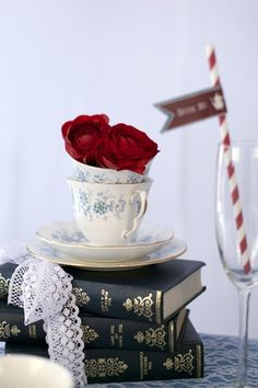 20 DIY Alice in Wonderland Tea Party ideas: Confetti Daydreams - Mix and match vintage books wrapped together with lace, china teacups and saucers and decorate with strings of pearls and flowers such as these roses in contrasting colors Tea Party Wedding, Diy Wedding, Wedding Ideas, Trendy Wedding, Wedding Blog, Luxury Wedding, Wedding Decor, Wedding Gifts, Wedding Inspiration