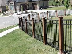 Image result for wood posts metal fence