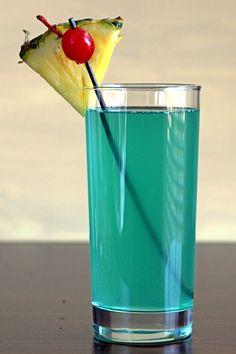 Carribean Mist drink recipe with Malibu Coconut Rum, Midori, blue curacao, pineapple, lemon and 7-up.