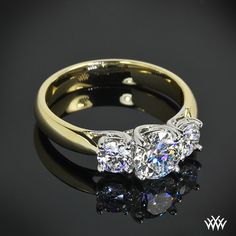 "two tone engagement ring, This beautiful 3 Stone ""Trellis"" Diamond Engagement Ring features 2 0.25ct A CUT ABOVE ® Hearts and Arrows Diamond side stones and a 0.80ct Premium Select center diamond."