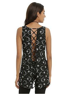 <p>You can be the moon and still be jealous of the stars. Make everyone else jealous of you when you wear this adorable top! Black tank top with an allover man in the moon and stars print, hi-low hem, cross strap and cross back panel detail.</p><ul>	<li>100% rayon</li>	<li>Wash cold; dry flat</li>	<li>Model is wearing size small</li>	<li>Imported</li>	<li>Listed in junior sizes</li></ul>