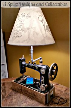 Art deco sewing machine turned into a lamp with USB charger outlet. Follow us for more wonderful pins at www.pinterest.com/3spurzdandc www.facebook.com/3SpurzDesignsAndCollectables www.3spurzdesignsandcollectables.com