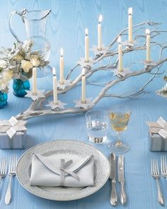 Candlelit Branch: Celebrate the Festival of Lights with an impressive manzanita-branch menorah, sprayed shimmering silver and trimmed with star-shaped bobeches.