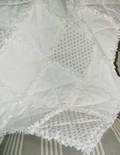 Love this all white rag quilt! Find a tutorial for creating a rag quilt at Shabby Chic Inspired. Tutorial shows a pretty flannel version.