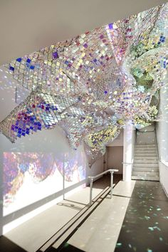 thousands of iridescent acrylic Plexiglas squares inserted into a chain link fency by Soo Sunny Park & Spencer Topel