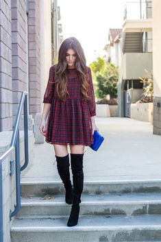 Plaid dress and suede over-the-knee boots. Perfect holiday party look. Winter fashion.