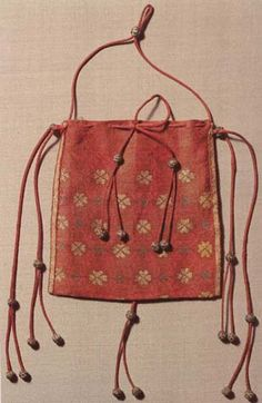 """Byzantine relic pouch from the or century; Michael in Beromünster, Switzerland; """"lattice-work wreath pattern worked on a [silk] ruby red ground. It is made from a single linen-lined piece of cloth, and has seams on two sides Medieval Costume, Medieval Dress, Medieval Fashion, Medieval Clothing, Textiles, Meme Costume, Medieval Embroidery, Early Middle Ages, Tablet Weaving"""