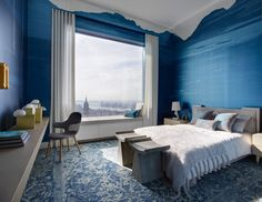 432 Park Avenue penthouse receives makeover from Kelly Behun Two guest bedrooms are decorated in contrasting colours: one with light walls and the other lined in a deep blue.