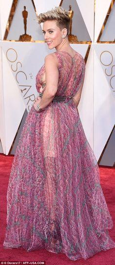Pretty in purple: Scarlett Johansson poses hand on hip, in her belted chiffon dress...