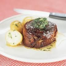 Bacon wrapped filet steaks topped with roasted garlic butter recipe