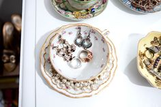 Organize This: Jewelry! | BHG Style Spotters; Using teacups to store jewelry on display.
