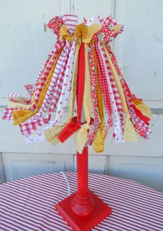 This would be really cute in a craft room. ~ http://20northora.blogspot.com/2012/09/lamp-redo.html
