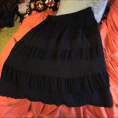 Black maxiskirt Black maxiskirt with three lace inlays. The skirt is black although the middle picture is gray it was washed out from the photo. This is been gently worn but still has some life left in it. Very comfortable Lane Bryant Skirts Maxi