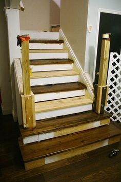 Shortened length of banister and widened bottom of stairs