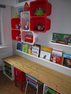 Colorful Shelving made from IKEA plastic boxes. I also like how the table / workspace is done. Desk along the wall. Want a desk for kids' playroom.