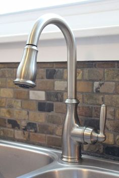 Sink and Faucet that was ordered online.  •Faucet: Moen 7185CSL Brantford  •Sink: Kraus KTM32