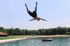 Brian Sanabria, 15 of Teaneck, flips off the diving board while cooling off and swimming at Darlington County Park.