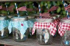 Canning jars as glasses for a patriotic party. The fabric over the jar (with ring secured on top) prevents an bugs from landing in your drink.