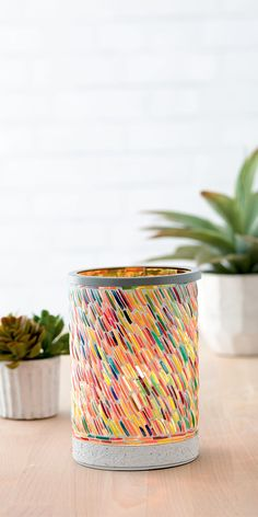Available March 1st beautiful multi color warmer make with recycled bracelets from India!