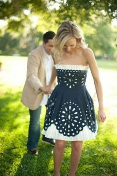 Cute white dress with black cutout overlay.