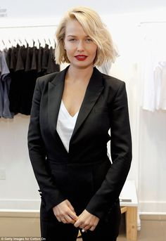 Understated: The 26-year-old model and fashion designer paired a white T-shirt from the range with a stylish black tuxedo for the event