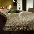 Photos and Videos | Cambria Kitchen, Bath & Commercial Projects.  Curved island is an eye catcher. #CambriaQuartz