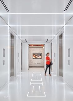 LED ribbons shine through acrylic set into the epoxy floor of the elevator lobby. Photography by Ryan Gobuty/Gensler.
