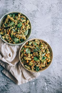 Very green vegan pasta salad with pesto, roasted chickpeas and aromatic herbs