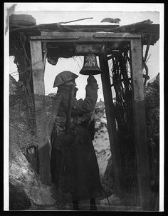 Gas alarm in the front line, 1918.