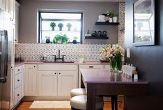 Kitchen Cousins - Pretty and Pink Episode - Antique white cabinets, Heath ceramic backsplash with black grout, pink Caesarstone Supremo countertops (queen of hearts), stainless steel appliances, cabinet pulls Stone Kitchen, Kitchen Dining, Kitchen Redo, Kitchen Cousins, Hgtv Star, Diy Décoration, Kitchen Countertops, Quartz Countertops, Kitchen Backsplash