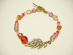 Red and pink bracelet with leaf part beaded by Coloramelody