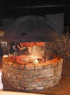 Central fire - people can sit around the outside. Must be a able to cook over it (whole hog)