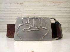 Raised Fist stainless steel belt buckle by BrownDogWelding on Etsy, $40.00