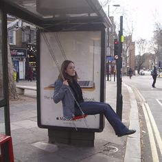 Swings at the bus stop; a great idea to make waiting for the bus a fun experience!