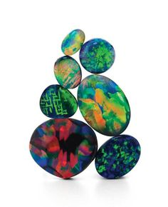 With black opals, the general rule is the darker the base and the colour bar sitting on top of it, the greater its worth per carat. Red hues are also highly prized.