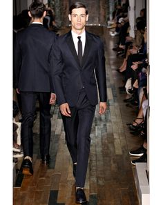 """Valentino """"I think this could be the first time I looked at a runway photo on my computer screen and said 'Holy shit' out loud. The color, the fit, the hair—pure perfection.""""—E.J. Samson, editor"""