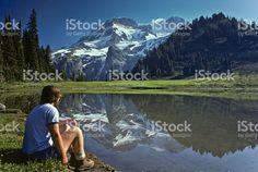 Young Female Hiker at Aurora Lake with Mt Rainier Reflection royalty-free stock photo