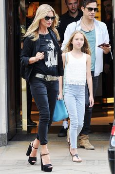 Kate Moss dresses up her casual t-shirt and jeans with a killer pair of platform heels