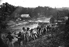 A party of the 50th New York Engineers builds a road on the south bank of the North Anna River, near Jericho Mills, Virginia, on May 24, 1864. (Timothy H. O'Sullivan/LOC)