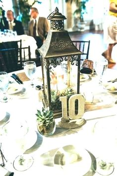 lantern centerpieces, succulents and bold table numbers, photo by Daybreak Studios -Mary & Sam, if this interests you I have at least a dozen of these in different shapes and sizes -glass/wood and glass/metal. Mod Wedding, Wedding Table, Fall Wedding, Rustic Wedding, Dream Wedding, Garden Wedding, Lantern Centerpieces, Succulent Centerpieces, Wedding Centerpieces