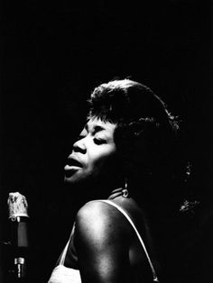 Sarah Vaughan performs at the Newport Jazz Festival, Newport, Rhode Island, 1961.   (Photo by Adger Cowans/Getty Images)