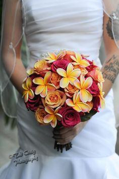 Plumeria and Roses~ Very tropical colors #plumeriaandrosebouquet, #weddingbouquet Photo by Tad Craig Photography
