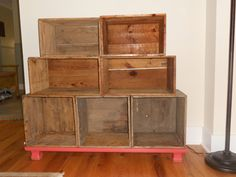 Bookcase using wooden crates. Maybe use as a side table/ short wall.