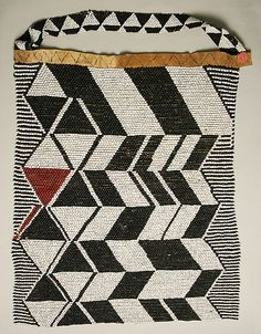 Apron Date: early 20th century Culture: African Medium: glass, leather, plastic, cotton Dimensions: Width: 14 x 24 in. (35.6 x 61 cm)