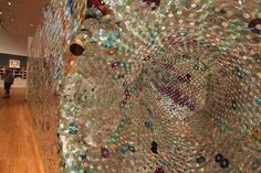 Entropy: A Vortex of Useless Memory (2009) by Leticia R. Bajuyo. Over 5,000 CDs and DVDs were fixed with fishing wire to a wooden frame.  [ #CDs #installation #music #sculpture ]