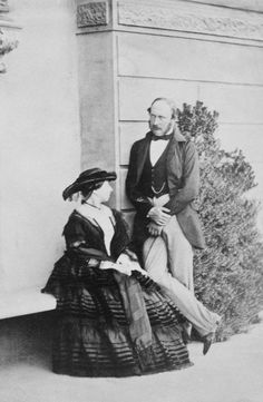 Photograph of Queen Victoria (1819-1901) and Prince Albert, Prince Consort (1819-1861) on the terrace at Osborne House. Photograph of Queen Victoria (1819-1901) and Prince Albert, Prince Consort (1819-1861) on the terrace at Osborne House. The Queen is seated on a bench and the Prince is stood to her left. ...