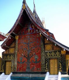 Wat Xieng Thong, Luang Prabang, Laos.  Have not seen one picture yet that does this building justice.