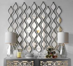Reflect your style with our Single Silver Teardrop Panel Mirror. With a teardrop panel design this mirror adds maximum shine to your home. Make a statement by hanging a few panels together!